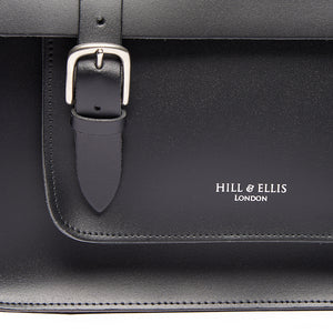 Black satchel cycle bag with detail of Hill & Ellis logo