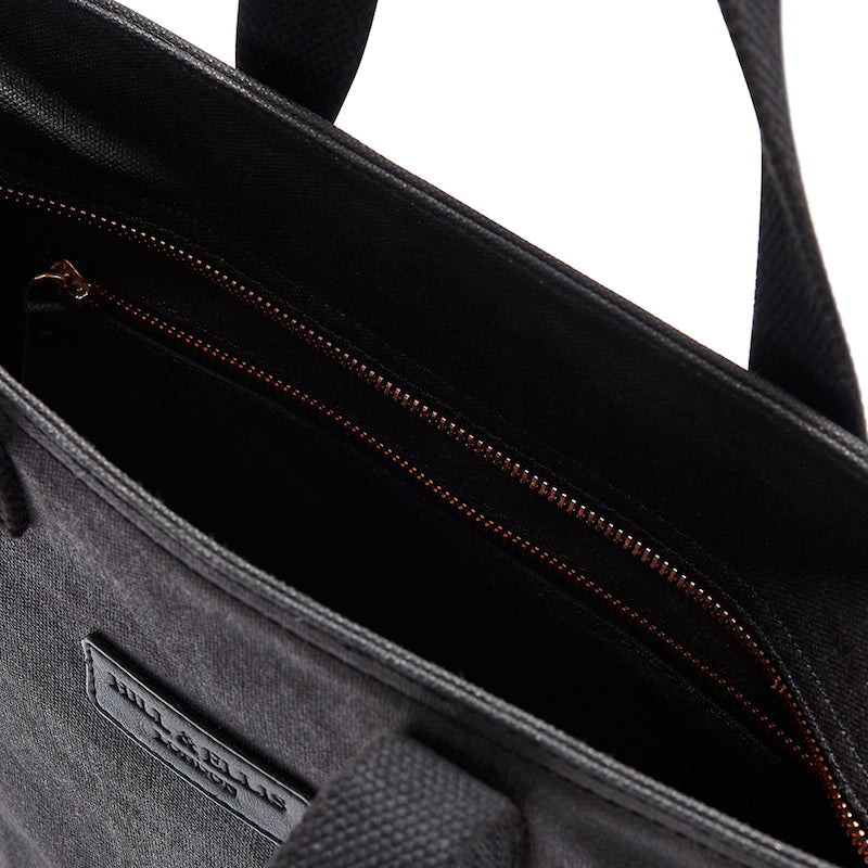 Black and copper canvas cycling bag detail of the inside