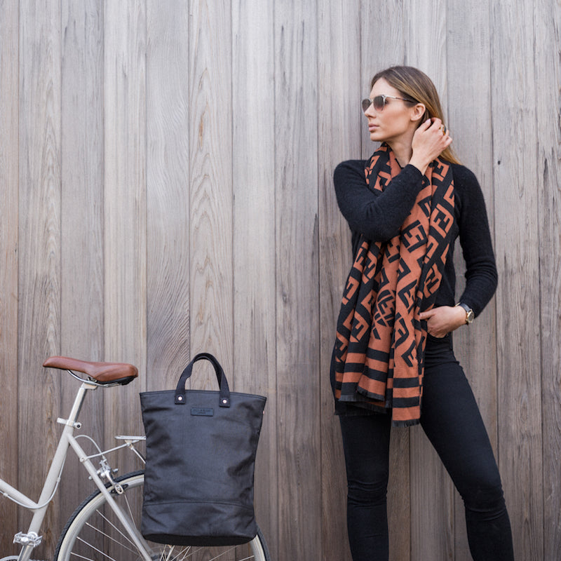 Black and copper canvas cycling bag on bicycle