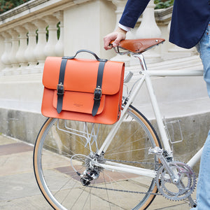 Orange leather satchel cycle bag on bicycle