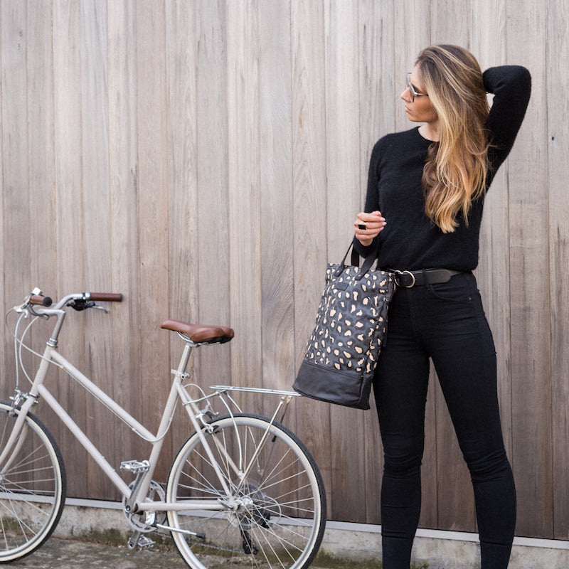 Leopard print canvas cycling bag with model
