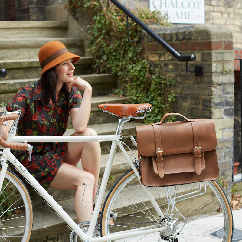 Tan leather satchel cycle bag on bicycle
