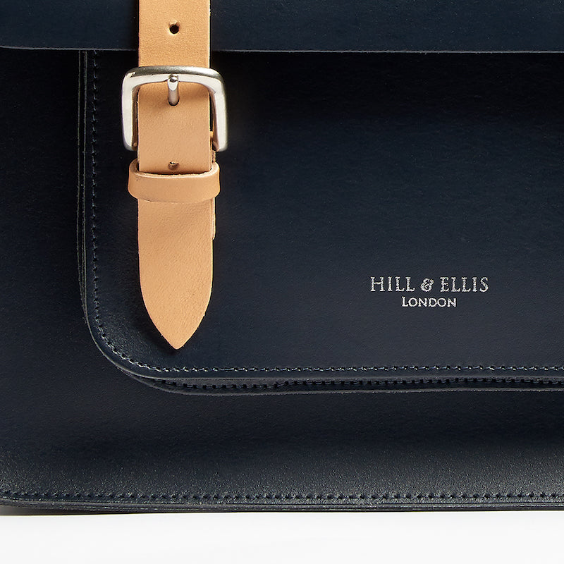 Navy and Tan leather satchel cycle bag detail of Hill & Ellis embossing