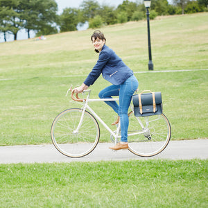 Navy and Tan leather satchel cycle bag on bicycle