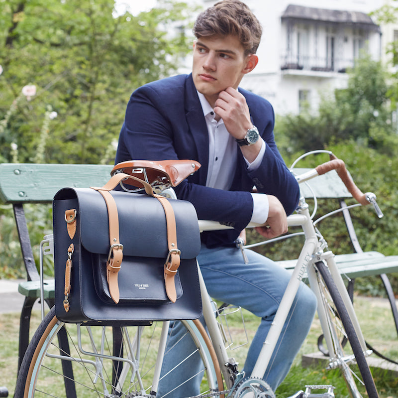 Navy and Tan leather satchel cycle bag attached to bicycle