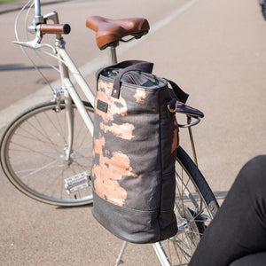 Copper print canvas cycling bag attached to bike