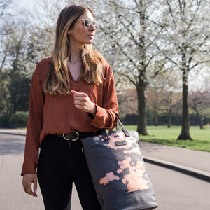 Copper print canvas cycling bag carried by a model