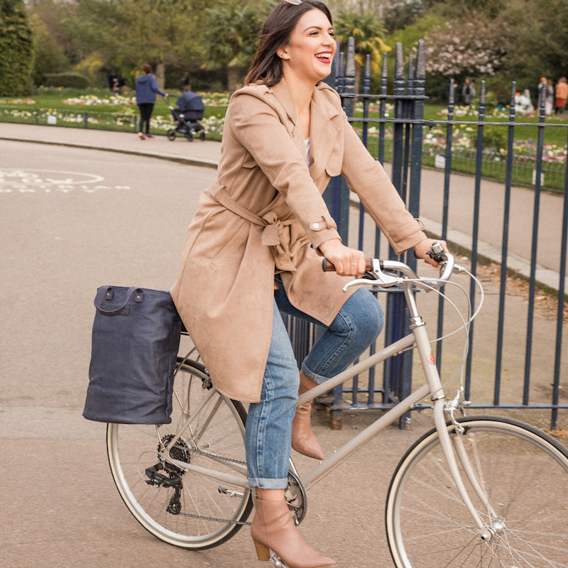 Load image into Gallery viewer, Hill and Ellis Skye navy canvas cycle bag on bicycle