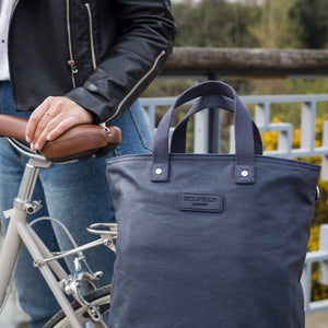 Hill and Ellis Skye navy canvas cycling bag on bicycle