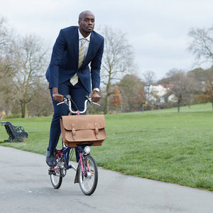 Tan leather Brompton compatible cycle bag modelled on brompton bicycle