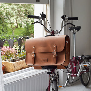 Tan leather brompton compatible cycle bag on bike
