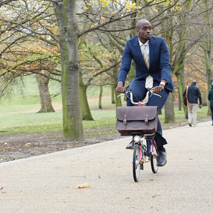 Load image into Gallery viewer, Brown leather brompton compatible cycle bag on brompton bicycle
