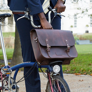Brown leather brompton compatible cycle bag on bicycle