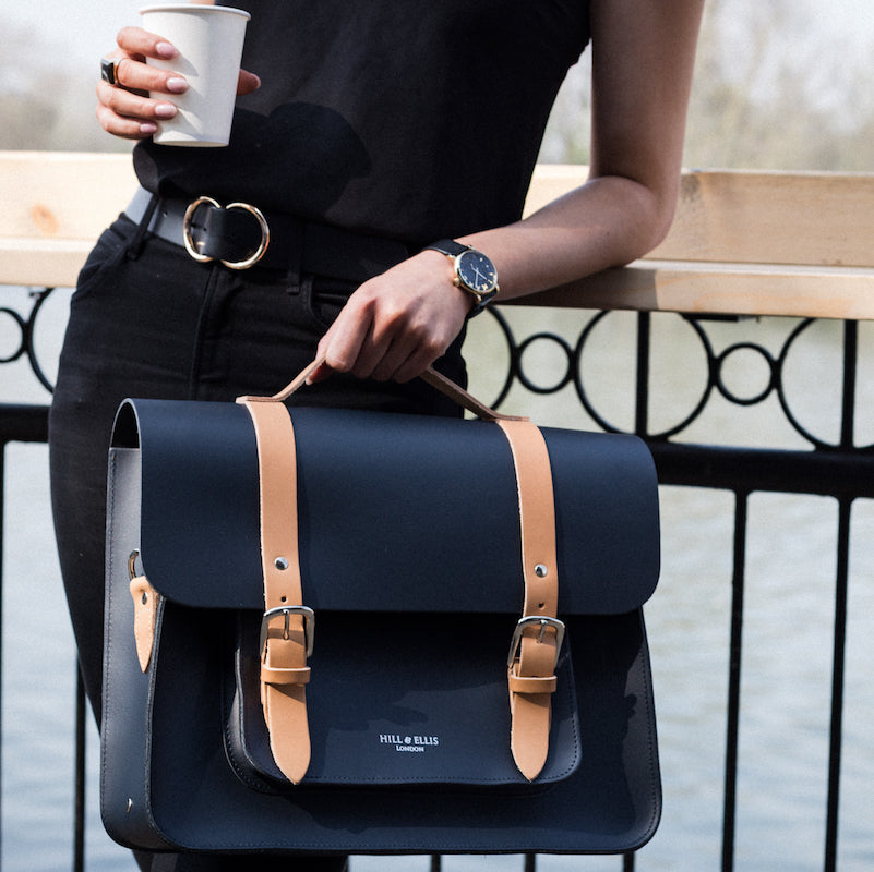 Navy and Tan leather satchel cycle bag with model
