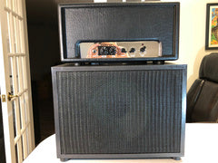 """1x12"""" cabinet - Front view with grill cloth and amp head stacked on top"""