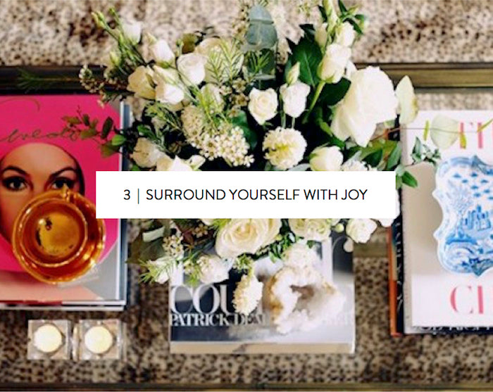 surround yourself with joy // coffee table flat lay