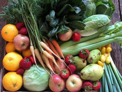 beautiful box full of colorful fruits and vegetables
