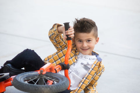 Shelby's son Declan posing on his bike