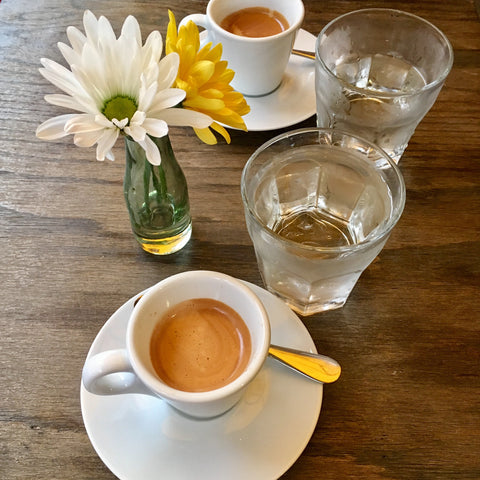 Espresso, a side of water and daisy's at Sapori d'Italia.
