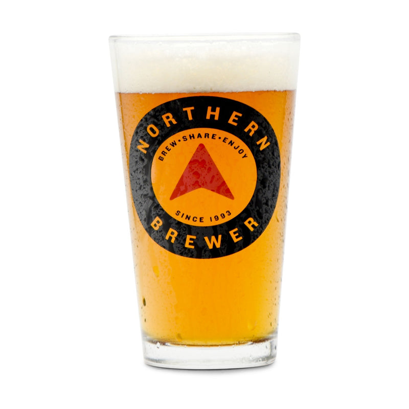 A northern brewer pint glass filled with homebrew