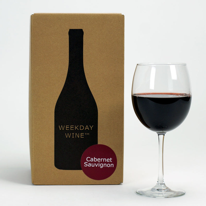 A Cab Sauv recipe kit box beside a wine glass