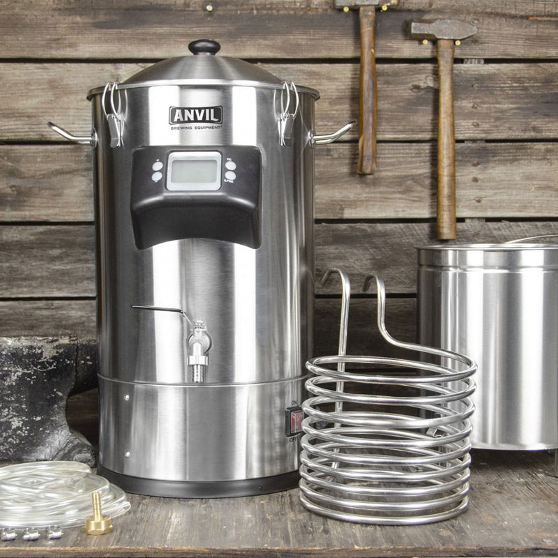 ANVIL Foundry™ 6.5 Gallon All-In-One Electric Brewing System showing individual components: grain basket, immersion chiller and tubing are next to the main unit