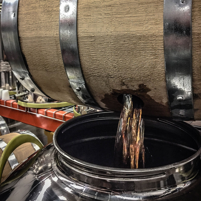 Studio Distilling barrel being drained