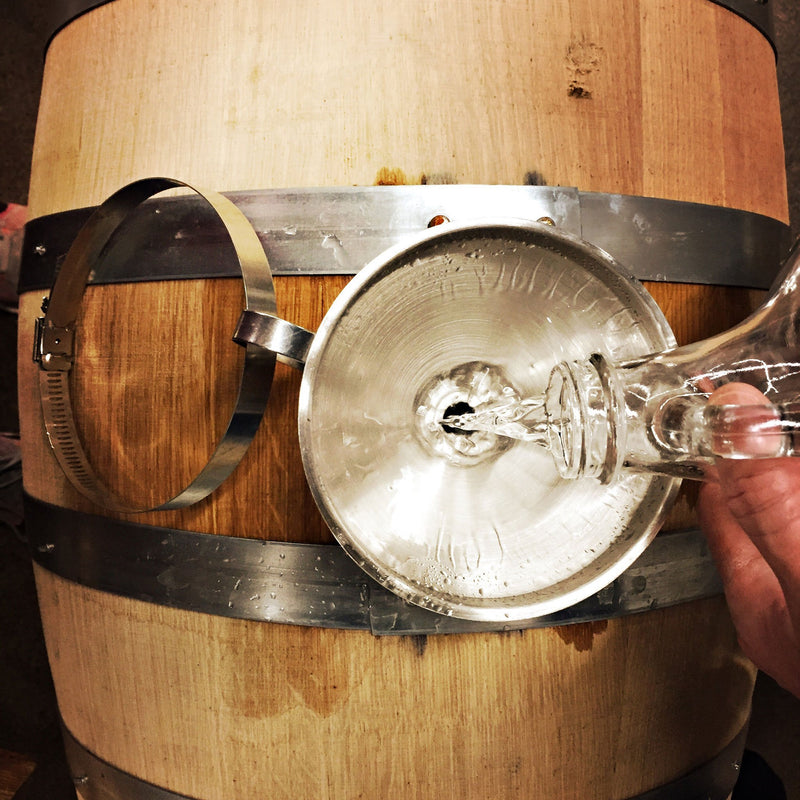 Studio Distilling barrel being filled