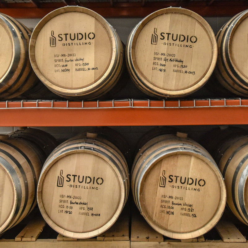 Close up of studio barrels on rack