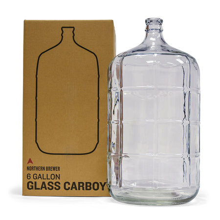 6 gallon glass carboy beside box