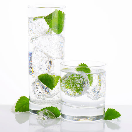 Mojito Hard Seltzer in two drinking glasses with mint leaves