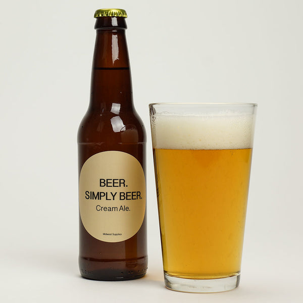 Beer. Simply Beer homebrew in a glass beside a labeled bottle