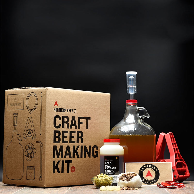 The one-gallon Craft Beer Making Kit with wort in the fermentor, as well as its fresh ingredients on display - One Gallon