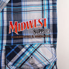 Close-up of the Midwest Supplies Plaid Work Shirt's logo