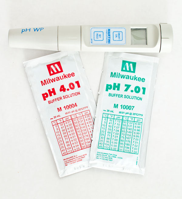 Milwaukee pH56 pH/Temperature Meter alongside 4.01 and 7.01 buffer solution sachets