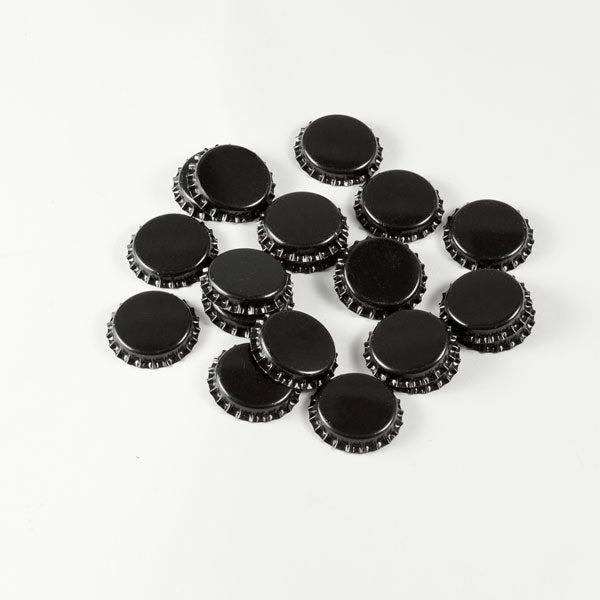 Black Bottle Caps in a pile