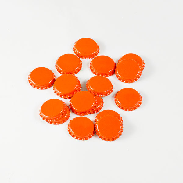 Orange Bottle Caps in a pile