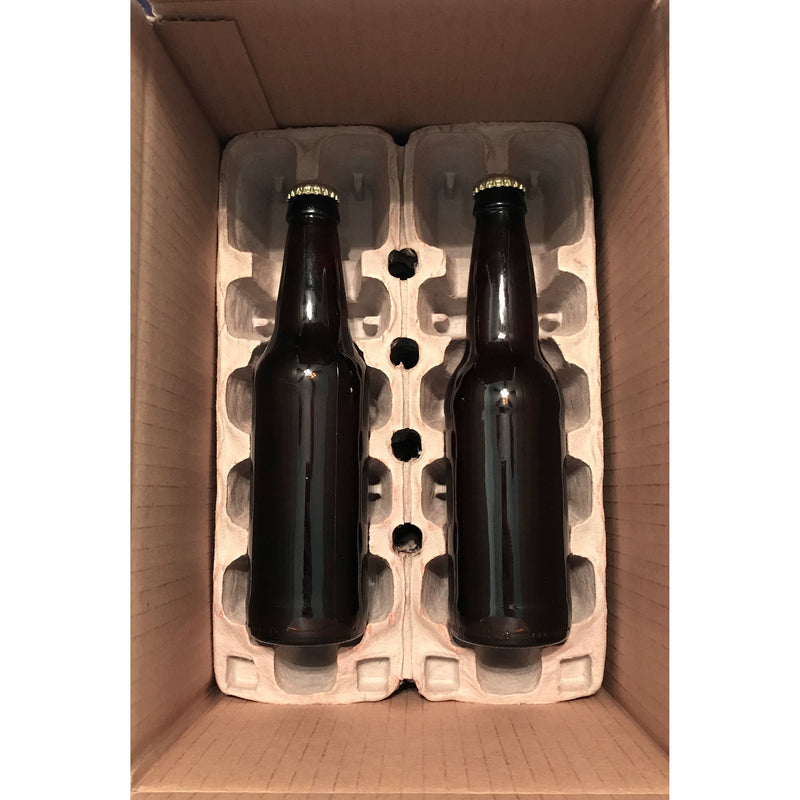 Two bottles within their bottle guards at the bottom of a shipping box