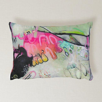 Artful printed lumbar pillow with two separate designs. 12