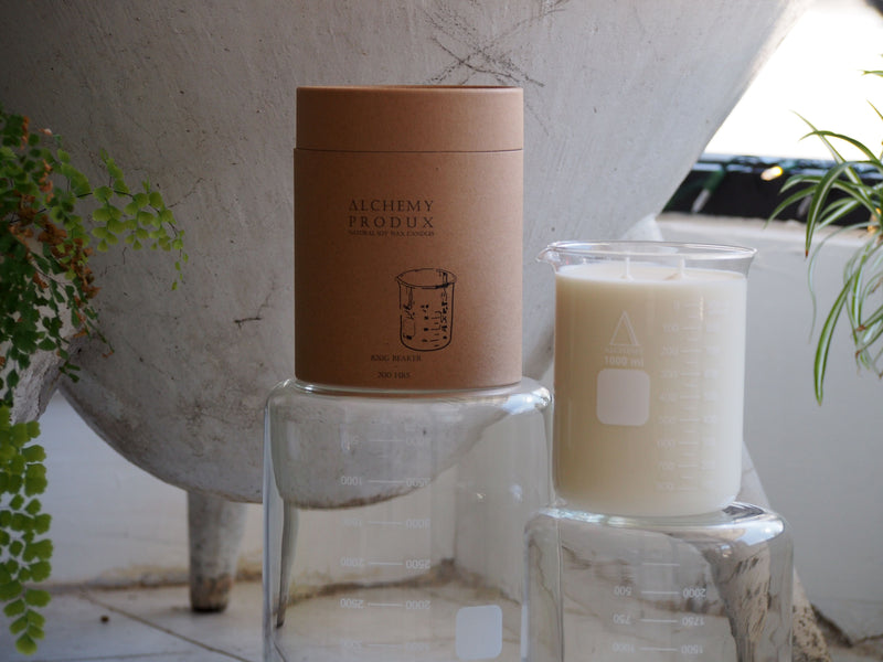 natural soy candle in a glass beaker alchemy