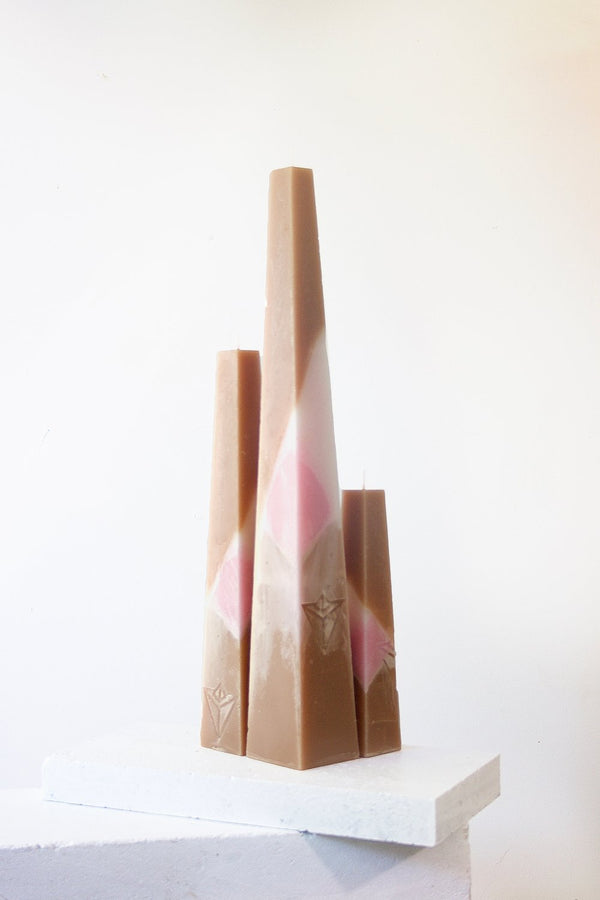 pink and caramel tall pyramid shape candle with crystals