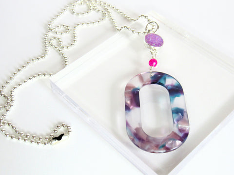 photo of Viola Necklace from Leo and Lynn Jewelry handmade resin jewelry Pittsburgh statement necklace spring style casual style purple blue acrylic hot pink crystal purple glitter