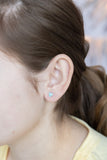Teeny Tiny Heart Crystal Silver Stud Earrings in Aquamarine | Annie and Sisters