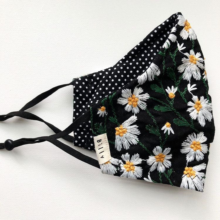 Embroidered Daisy face masks on black