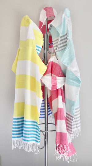 koton kulture toronto mississagua  turkish towel the classic in various colours white stripped poncho with tassels for babies kids at the beach, bath or pool