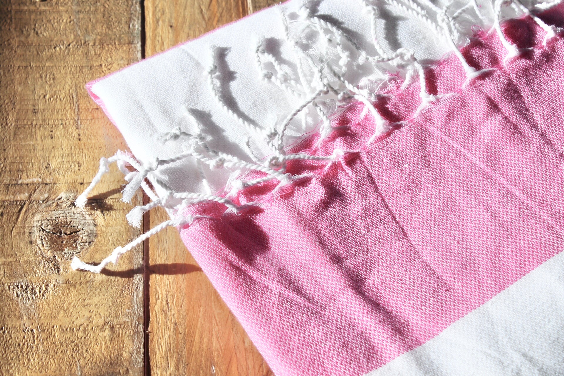 koton kulture toronto mississagua  turkish towel the classic in pink and white colours white stripped poncho with tassels for babies kids at the beach, bath or pool