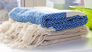 koton kulture toronto turkish towel diamond cut peshtemal with white stripe at the very bottom and tassels in various solid colours blue beige