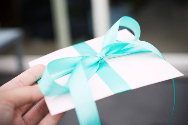 Koton Kulture Gift Card with a turquoise bow tie