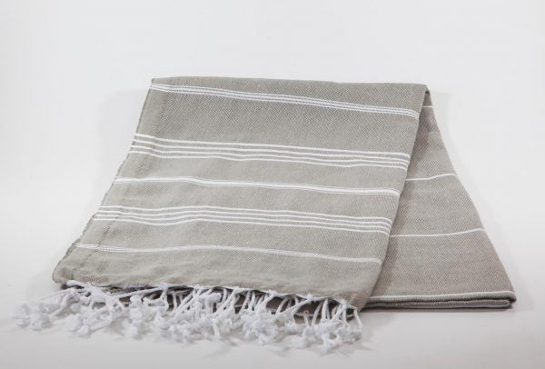 koton kulture toronto turkish towel grey comfort peshtemal with white variable stripes and tassels. base is full colour beige