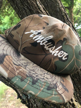 Load image into Gallery viewer, Ambusher Treestand Realtree Snapback